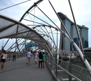 Singapore's Helix Bridge is built like a giant DNA helix wrapped around a walk way linking two sides of the Marina Bay area and the new Marina Bay Sands hotel and casino, pictured behind